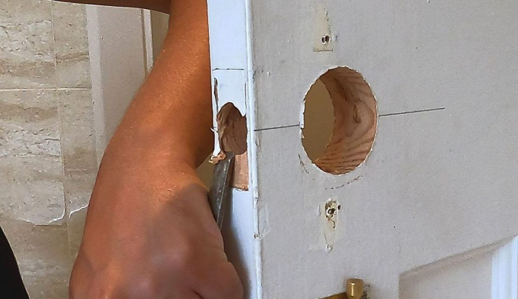 14-hand-chiselling-rebate-on-door-for-latch