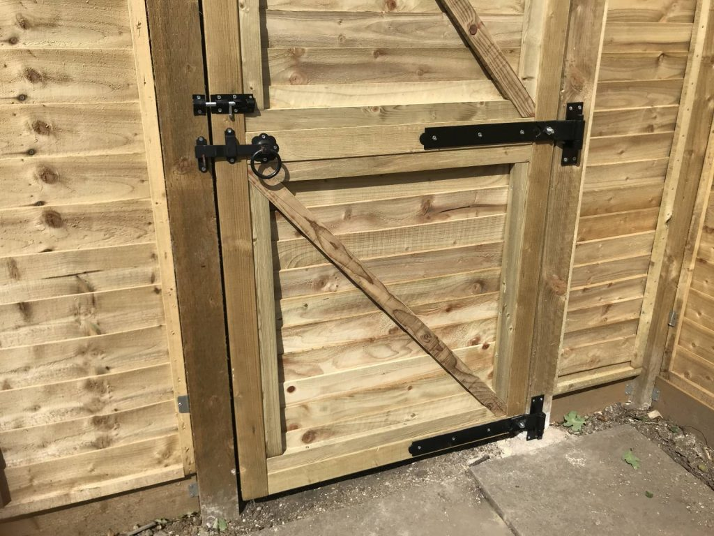 Band and hook hinges attached to gate post