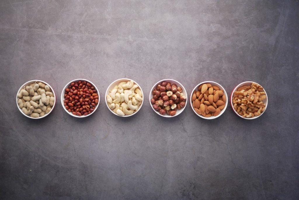 nuts-on-table-cashews-peanuts-almonds-walnuts-macadamias
