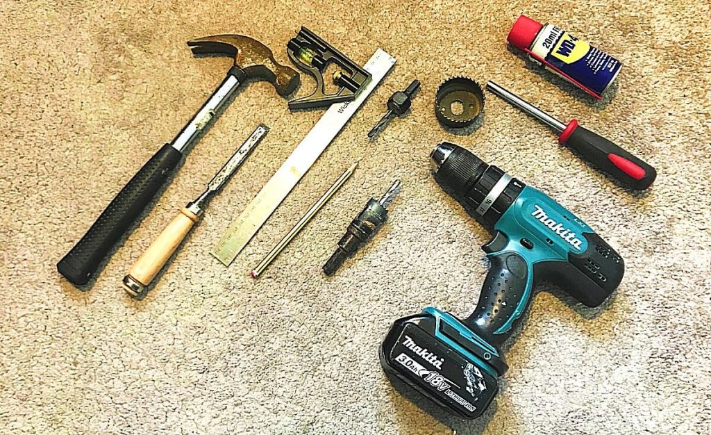 tools-required-for-fitting-door-knob-handle-drill-holesaw-hammer-combination-square (1)