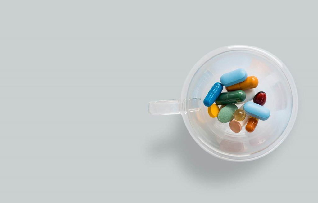 vitamin-tablets-in-a-glass-cup